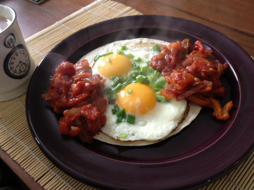 Huevos rancheros Mexican brunch. Salsa made from peppers chopped toms and onion with chilli flakes cumin and ground coriander. 5.5 syns for the WW tortilla wrap