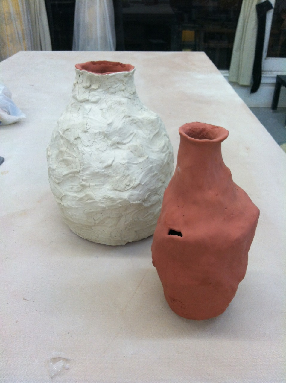 two porcelain vases ready for the gas kiln