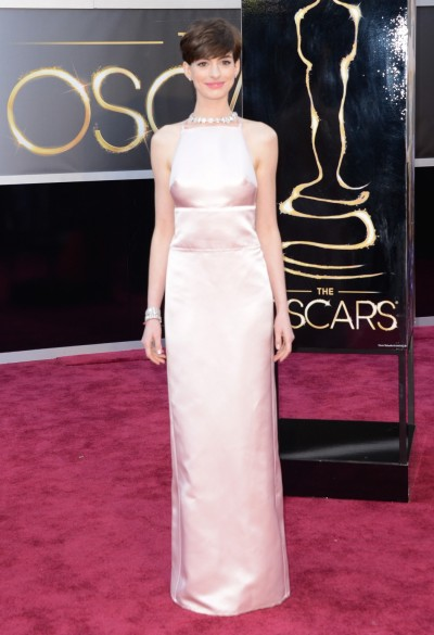 And the worst-dressed celebrity at the Oscars is… Anne Hathaway in Prada! I'm sorry, but this was just. So. Disappointing. Yes, there were worse disasters out there (Brandi Glanville, anyone?), but we expect the Real Housewives to look like that. We expect Anne, however, to look gorgeous, especially on the night she was slated for her big win! While she could have knocked me dead in something bright and beautiful, she left me mopey over her boxy, stiff dress with the built-in nipples.  Honorable Mentions: Brandi Glanville in ? Giuliana Rancic in Rafael Cennamo Kelly Rowland in Donna Karan Kristen Stewart in Reem Acra Sunrise Coigney in Zero + Maria Cornejo