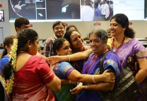 "notyourexrotic:   This week, India became the first Asian nation to reach Mars when its orbiter entered the planet's orbit on Wednesday — and this is the picture that was seen around the world to mark this historic event. It shows a group of female scientists at the Indian Space Research Organization (ISRO) congratulating one another on the mission's success. The picture was widely shared on Twitter where Egyptian journalist and women's rights activist Mona El-Tahawy tweeted: ""Love this pic so much. When was the last time u saw women scientists celebrate space mission?"" In most mission room photos of historic space events or in films about space, women are rarely seen, making this photo both compelling and unique. Of course, ISRO, like many technical agencies, has far to go in terms of achieving gender balance in their workforce. As Rhitu Chatterjee of PRI's The World observed in an op-ed, only 10 percent of ISRO's engineers are female.This fact, however, Chatterjee writes, is ""why this new photograph of ISRO's women scientists is invaluable. It shatters stereotypes about space research and Indian women. It forces society to acknowledge and appreciate the accomplishments of female scientists. And for little girls and young women seeing the picture, I hope it will broaden their horizons, giving them more options for what they can pursue and achieve."" To read Chatterjee's op-ed on The W"