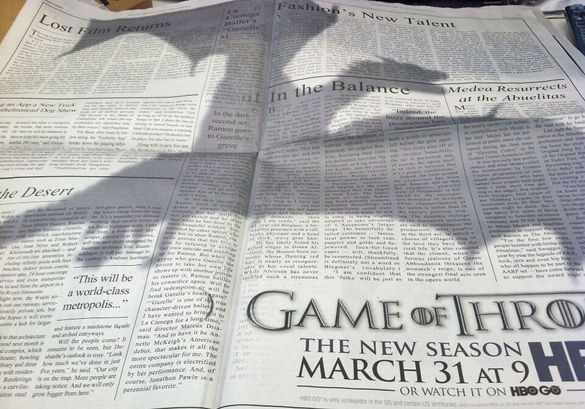 parislemon:  robsheridan:  Fantastic advertising for Game of Thrones in the New York Times (the dragon shadow is printed on the paper over regular articles). More  Excellent.