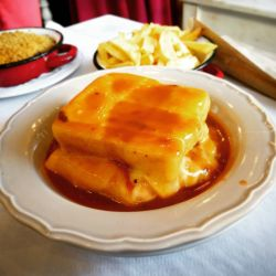 A worthy contender for best Francesinha in Porto at A Casa do Evaristo. Seriously good and only 7.50 for the whole thing! #foodie #foodlover #portugal #travel #foodie #sandwich #Porto http://ift.tt/1T0a3lH