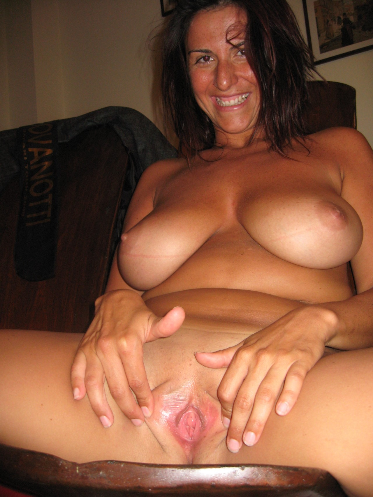 Mom showing her shaved pussy