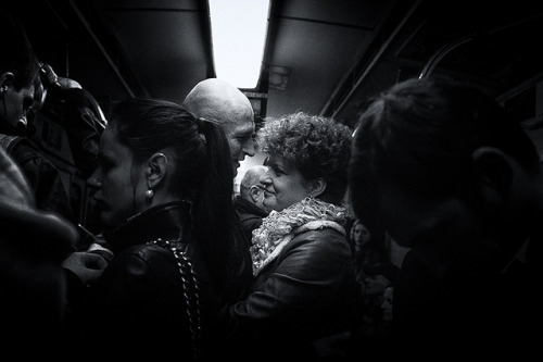 Whispering in Subway on Flickr.