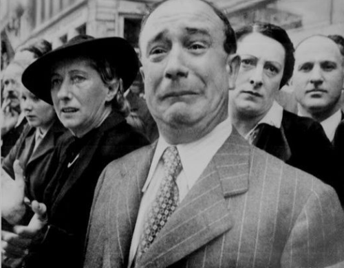 A Frenchman cries as the Nazis occupy Paris in May 1940.