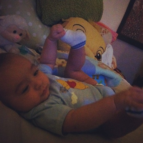 This is ALL he does now, lol. He grabs his toes SO much it makes changing diapers so difficult -___-