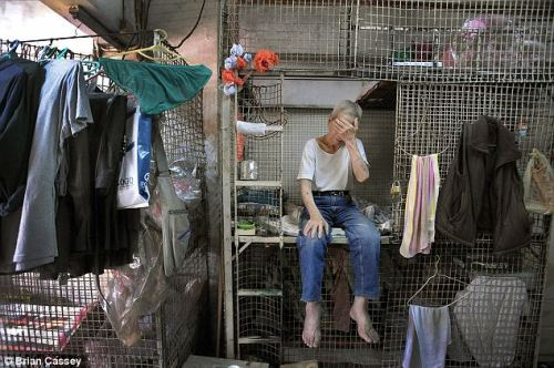 "Tai Lun Po, 79 years old, has called this Hong Kong cage ""home"" for 30 years. Read more here and here."