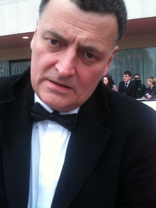 thewolfsinyourbed:  Steven Moffat at the BAFTAs , after finding out that the blu rays were sent out early. i have never been so gigglingly happy about someone's misery before.