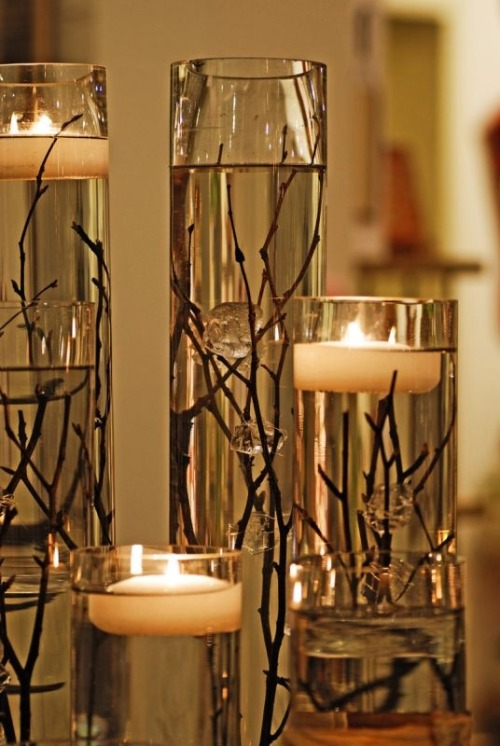 acqua-di-fiori:  Stick and Candles.  I absolutely love this idea. :)