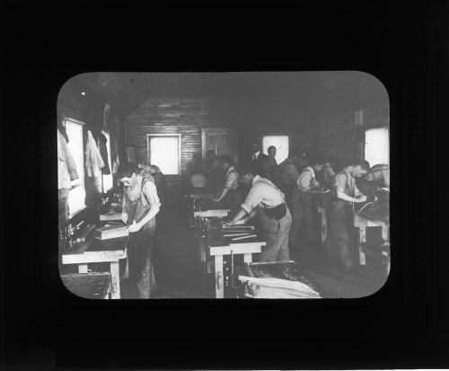 Boys working in machine shop,  Rainsford Island, circa 1910-1920, Institutions Department lantern slides (Collection #8500.002)  This work is free of known copyright restrictions. Please attribute to City of Boston Archives For more images from this collection, click here
