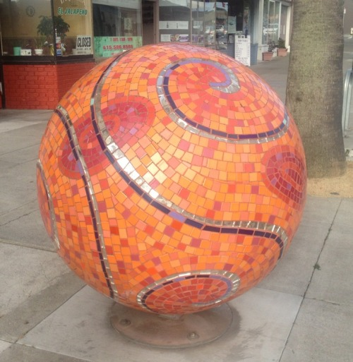 One of the three inexplicable orange mosaic balls on Ocean