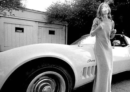 Stars & Cars: Joan Didion We're sort of obsessed with Joan Didion's swagger while posing beside her sassy white Stingray in Hollywood back in 1970. Her understated sense of style and grace inspired us to scope through eBay for similar Stingrays. Much to our surprise, we found a few sexy similar models with one bid starting at $6,500. Only strong women need apply.  (Photo: Julian Wasser/Time Life Pictures/Getty Images. Text by Jauretsi)
