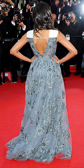 Better From The Back? Zoë Saldana The Queen of Cannes looks regal in a blue brocade Valentino gown with white shoulder detailing. See the look from all angles here!
