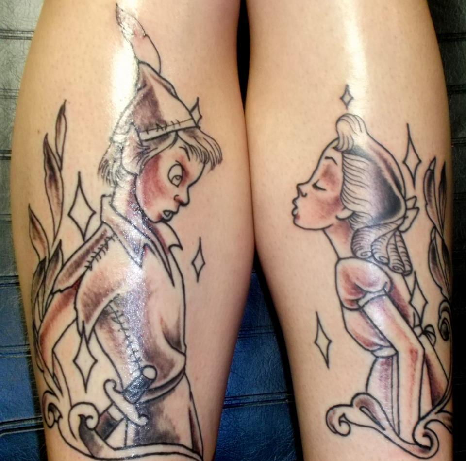 fuckyeahtattoos:  Peter Pan and Wendy on my shins.  Done at Guilty Pleasures in San Diego, CA by Gust Razo  Those are my shins! :D