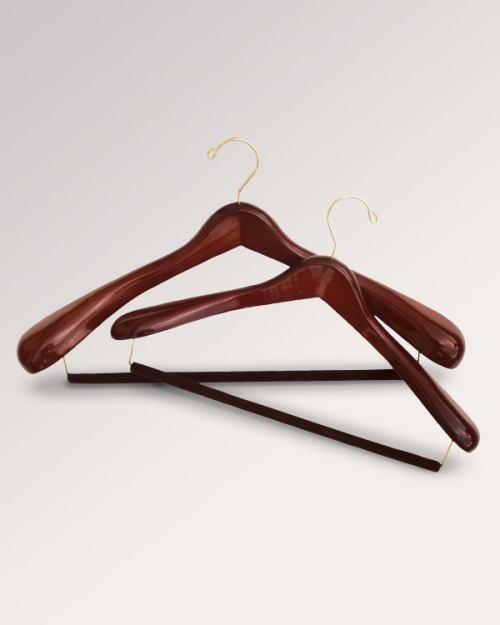 "putthison:  We Got It For Free: High-Quality Hangers Men's clothing enthusiasts often stress the importance of using specialized hangers for suits and sport coats. It's not an empty claim, since tailored jackets have their own form, and these forms need to be preserved. If a jacket has been well-made, its fabric will have been moulded through a lot of hand pressing and ironing in order to give it a certain three-dimensional shape. The claim is that if we use improper hangers – ones that don't imitate the width and curvature of our shoulders – a jacket's form can be ruined. I admit I've always been skeptical of this, yet I've also never used anything but contoured hangers. Whether or not regular hangers are actually bad for tailored jackets, I've never been willing to take the chance.  Last month, The Hanger Project - who many say makes some of the best specialty hangers - sent me some of their products for a review. Their shirt hangers are simple enough, though probably better looking than anything else you'll find on the market. They also have flocked trouser hangers that allow you to avoid the creasing that can result from a locking bar. Their most impressive hangers, however, are those made for suits and sport coats. These are shaped in a way to closely resemble how a man's shoulders naturally curve forward, and the ends flare out to an impressive 2.5"" in width. This might sound excessive, but again – one should remember that a well-tailored sleeve is shaped through a lot of hand pressing with a heavy steam iron, and that shape presumably should be supported. Fortuitously, a day after The Hanger Project's package arrived, I went to have drinks with a rather renowned (and very fair minded) tailor from Savile Row. I took the opportunity to ask him whether such specialized hangers really make a difference. He said absolutely. An improper hanger could easily ruin a jacket's shoulder line, which is one of the most critical parts to how a jacket fits. He also said The Hanger Project's hangers are the best he's ever come across. So, my skepticism has been assuaged. There are two downsides to The Hanger Project's products, however. The first is that their suit and sport coat hangers take up considerably more room. That's necessarily so since they have such curved and wide shoulders, which are designed to support a jacket as ideally as possible. If you can't afford the space, you can try their travel hangers, which are a bit narrower. The other downside is obviously the price. Their flagship suit hangers, for example, are $25 a piece, so these aren't exactly cheap. For an affordable alternative, there's Wooden Hangers USA. The woods they use aren't as nice, and sometimes they have slightly rougher edges (though nothing that I think would damage a jacket). They also cover their trouser bars with a slightly less effective ridged vinyl, rather than flocking them. Perhaps most importantly, their suit hangers' shoulders aren't as curved and wide, and they come in sizes that might not be as ideal. I wear a 36 coat, for example, and The Hanger Project's 15.5"" wide hangers fit my jackets perfectly. The sleeves are supported just at the right points, whereas Wooden Hangers USA's products push them out a bit. Still, Wooden Hangers USA has some truly wonderful products at affordable prices. Their stuff feels sturdy in the hand, comes in nice finishes, and features 2"" shoulders (just a bit less than The Hanger Project's 2.5""). I'd say they set the baseline for what a decent quality hanger should be. If you can't afford The Hanger Project's products, Wooden Hanger USA's will certainly be better than the free wire ones you get from the dry cleaners. And if one is buying high-quality tailored jackets, a $7 hanger from Wooden Hangers USA, or a $25 hanger from The Hanger Project, might be worth the investment.   (Pictured above: The Hanger Project's suit hangers)"