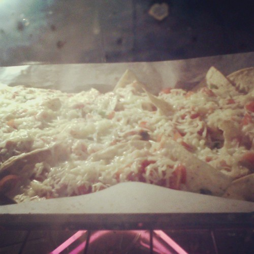 Watching that cheesy goodness just get all gooey ;D #foodporn #nachos #cheesy #yum