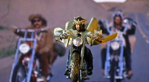 "Jesus Celebrates Easter…Easy Rider Style You can't really blame the guy.  After a few too many ""Wishing you an Awesome Good Friday"" texts, Jesus got up off the couch, grabbed his keys and said, ""I'm outta here.""  He left without saying another word. Kirk muttered something about ""Jesus ruining every Easter.""  I stared at him long and hard.  Kirk doesn't like people staring at him, especially if he says something stupid, which is always.  After a few minutes of pretending to read People, he threw down the magazine and said, ""what?""  Then he blinked a lot. I just got up and left Kirk alone with his eight or nine thoughts."