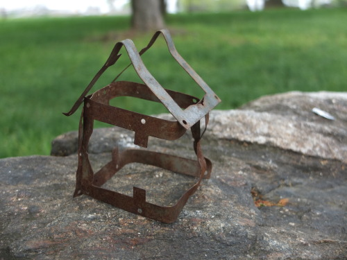 House made from 3 identical pieces of scrap metal placed on a rock on Randalls Island, NYC 2013