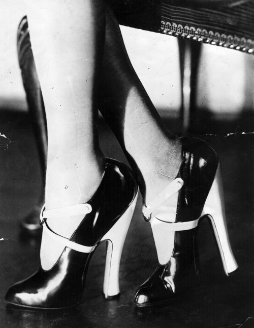 1920s Glam…Black & white patent leather high heeled shoes.