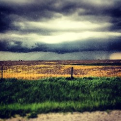 It's about to get nasty! #storm #clouds #rain #field #fence #grass #scary #nasty