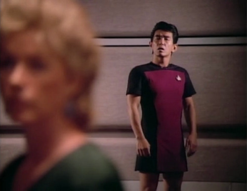 So I'm watching Star Trek: The Next Generation, Season 1 Episode 5, and it's kind of a serious part but they show this guy for a moment and I don't know why but I just found him so amusing and awesome. Maybe it's because his outfit looks more like the women's uniforms from the original series on a ship where even most of the females are wearing uniforms with pants that completely cover everything. I wonder if this guy is a reoccurring character or just a random background man… either way he is great.