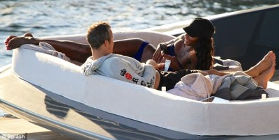 Vladimir Doroninlounging with Naomi Campbell's replacementin Miami on Tuesday…