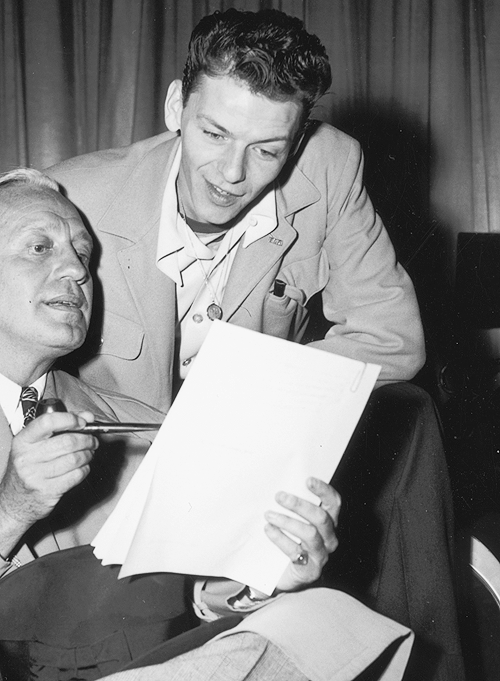 francisalbertsinatra:  Jack Benny and Frank Sinatra look over a script while preparing for a radio show, c. 1944