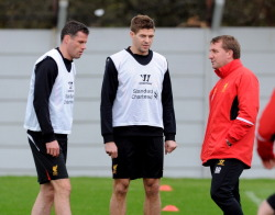 luca0713:  Jamie Carragher and Steven Gerrard talks with the manager of Liverpool Brendan Rodgers during a training session at Melwood Training Ground on April 25, 2013 in Liverpool, England. (via Getty Images UK)