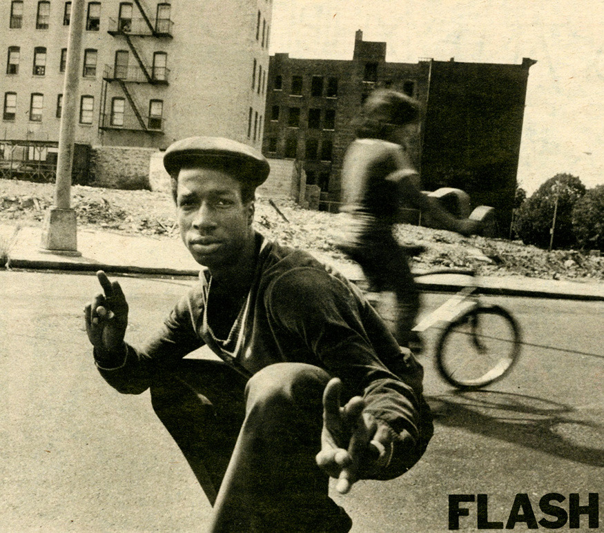 Grandmaster Flash by Joe Stevens for NME (1981) The South Bronx lies just across a thin stretch of the Harlem River from Manhattan, but it could be worlds away. Year by year Manhattan becomes more and more an island of privilege, the Bronx a wasteland. Cypress Avenue, the South Bronx, does not conform to one's image of the typical urban ghetto. It's not crowded and chocked, it's never been industrialised. The street doesn't give you that boxed-in feeling. There is space and sun and air. But the evidence of advanced decay is everywhere. The buildings at the end of the block are abandoned, their windows smashed or boarded up. Garbage and rubble is piled on the sidewalk. The vacant lots that dot the landscape are also strewn with rubble. Grandmaster Flash lives on this block. Continues