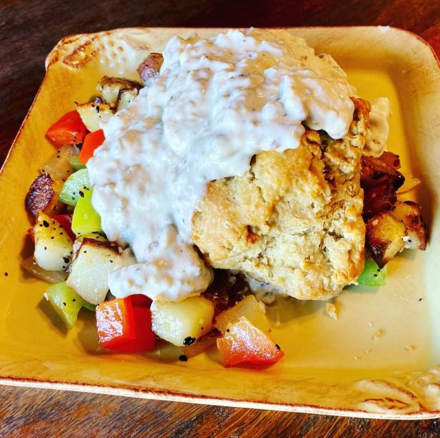 Biscuits @hollybsbakery and gravy on top of breakfast potatoes. Add an egg or ch...