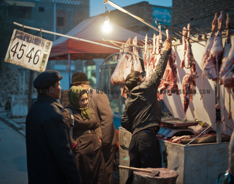 A Uyghur couple choosing the best cut of meet.Kashgar, Old Town, October 2012