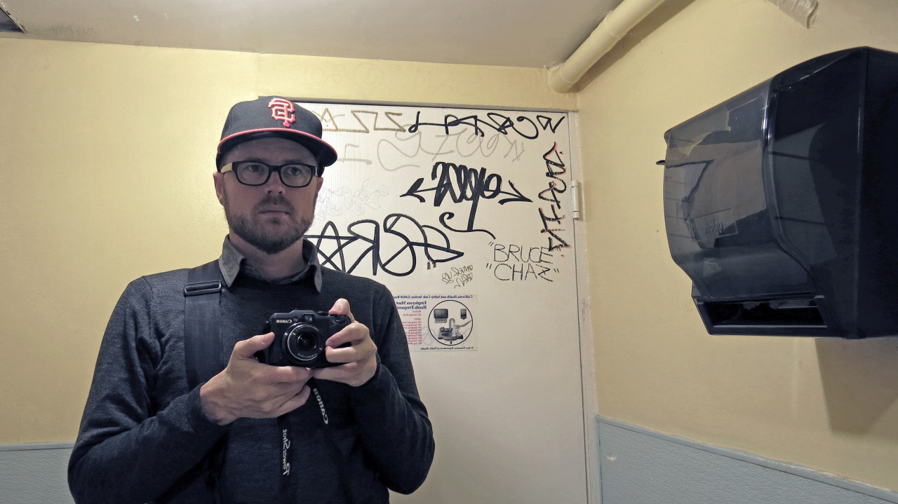 A Man, not Bruce Chaz, in the Restroom of a Restaurant in San Francisco's Little Saigon
