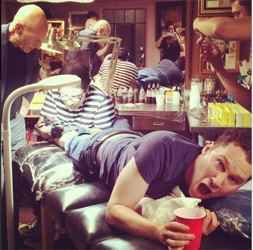 Bryan Singer gets tattoo to mark Days of Future Past crossing the $700 millon mark, as Patrick Stewart looks on.