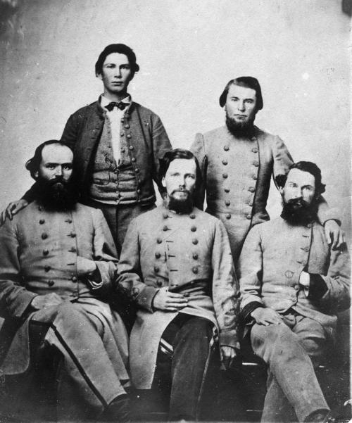 "Confederate Soldiers As the Civil War progressed the image of the Rebel soldier began to shift from the ""ragged rebel"" look to a well-uniformed Army in the Eastern and Western theaters. In the last 12 months of fighting these Confederate forces were well-uniformed, the best they had ever appeared in terms of consistency, wearing clothing made of imported blue-grey cloth, either manufactured locally or bought read-made under contract from British manufacturers, such as Peter Tait of Limerick, Ireland who became a major supplier of uniforms for the Confederacy. The use of wool in the uniform meant that the uniforms were not suited to the warm climates that were common in the South. This helped contribute to the fact that many Confederate soldiers suffered from heatstroke on long marches~Source: Mansfield, Howard, ""The Same Ax, Twice: Restoration and Renewal in a Throwaway Age"" page 33 http://en.wikipedia.org/wiki/Uniforms_of_the_Confederate_States_military_forces#cite_note-XY-1 Original Image found on Richmond History Center, no identifying information, names or date."