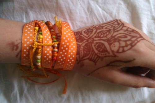 Self Injury Awareness day ribbon and bracelets (and my unrelated henna).