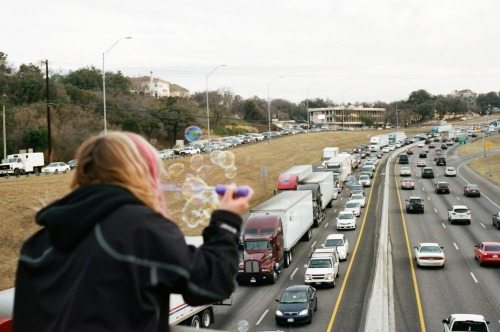 blowing bubbles on Austin rush hour traffic