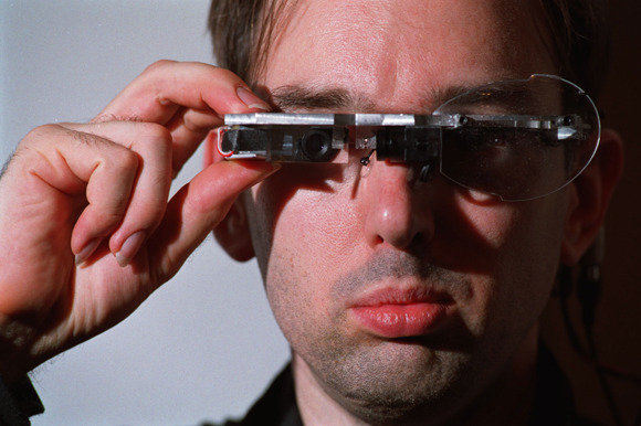 Matt Buchanan on wearable computers before Google Glass: http://nyr.kr/12Vi7Wb Above: Steve Mann adjusts his Eyetap. Photograph by Randy Quan.