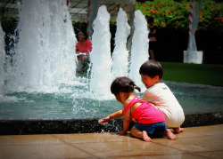 Playing in the fountain (by Mike Nay)