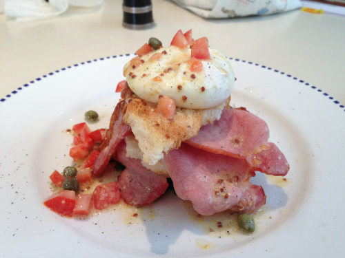 joewadsack:  Poached eggs, laid last night, on top of a stack of smoked back bacon and crispy polish toast, with a dressing of watercress, capers, Dijon mustard, tomato, olive and rice vinegar. Twist of pepper, and Bob's your Uncle.   Joe is the Breakfast King.