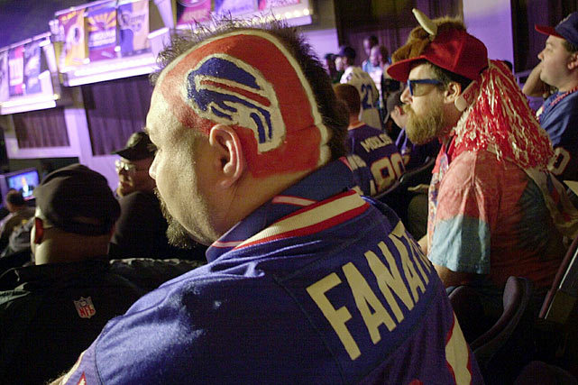 A Bills fan shows his allegiance during the 2002 NFL Draft. Who will the Bills take tonight with the No. 8 overall pick? Peter King has them choosing Chance Warmack, an offensive guard from Alabama. (AP) KING: My 2013 Mock DraftGALLERY: NFL Fans at Past NFL Drafts