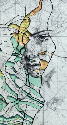 3inha:  Portrait carved from old military maps.Artist Ed Fairburn