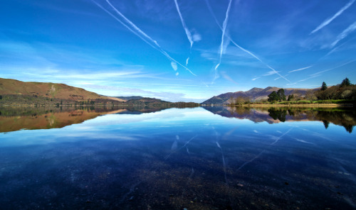Today's Photo Unity On The Water. On the last full day of our Keswick break, me and Lisabet made our way towards the tiny fell hamlet of Watendlath. But on the way, I espied through the trees gloriously clear reflections on Derwentwater, the kind I'd been looking for all week! We soon found a parking spot, leapt out of the vehicle, and started shooting all down the south and east shore of the lake, marvelling at the stillness of the water, the calm of the early morning and the colours all around us. =) You should order a beautiful print of this photo right here.