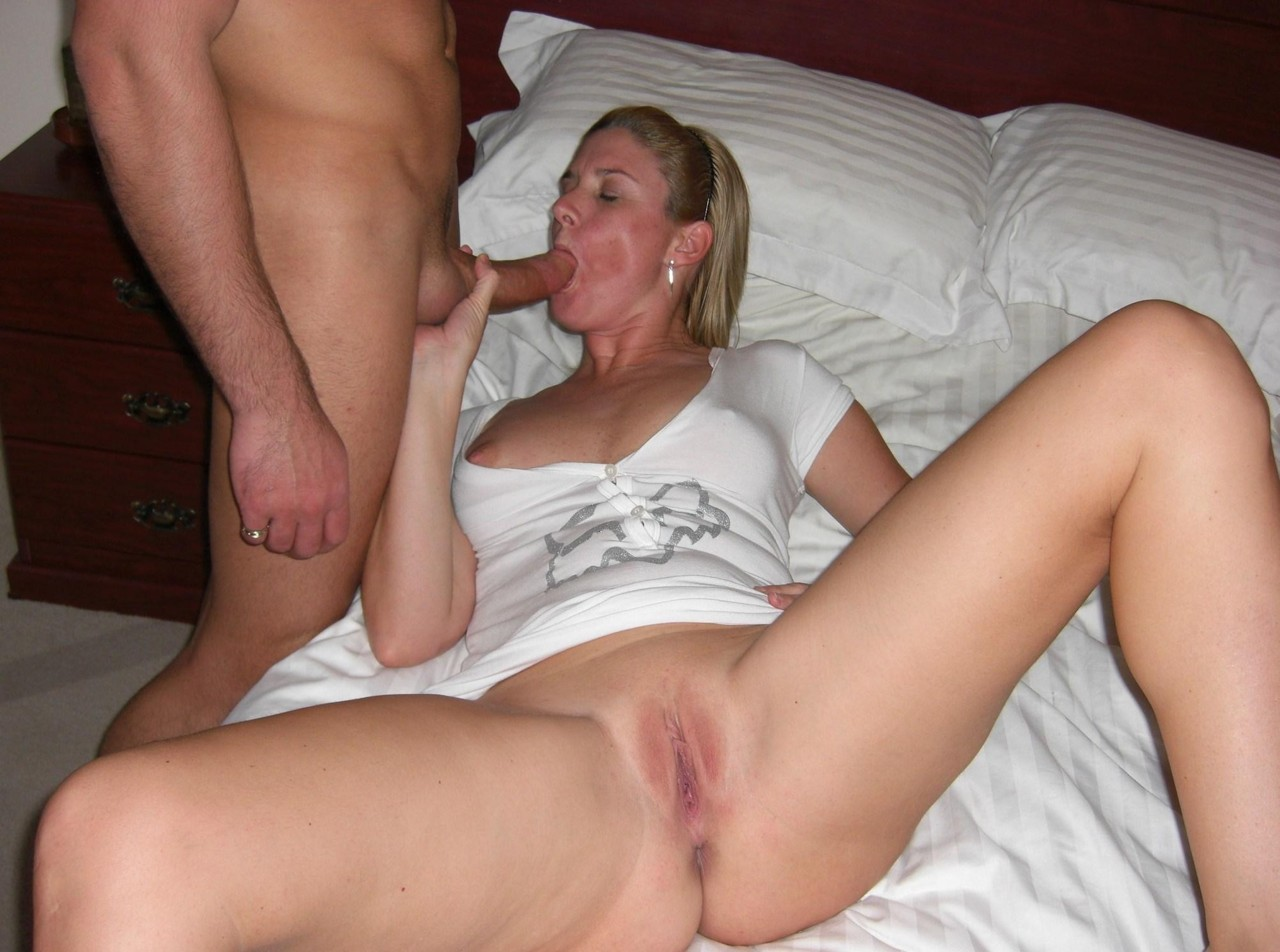 Mom spreads her shaved pussy