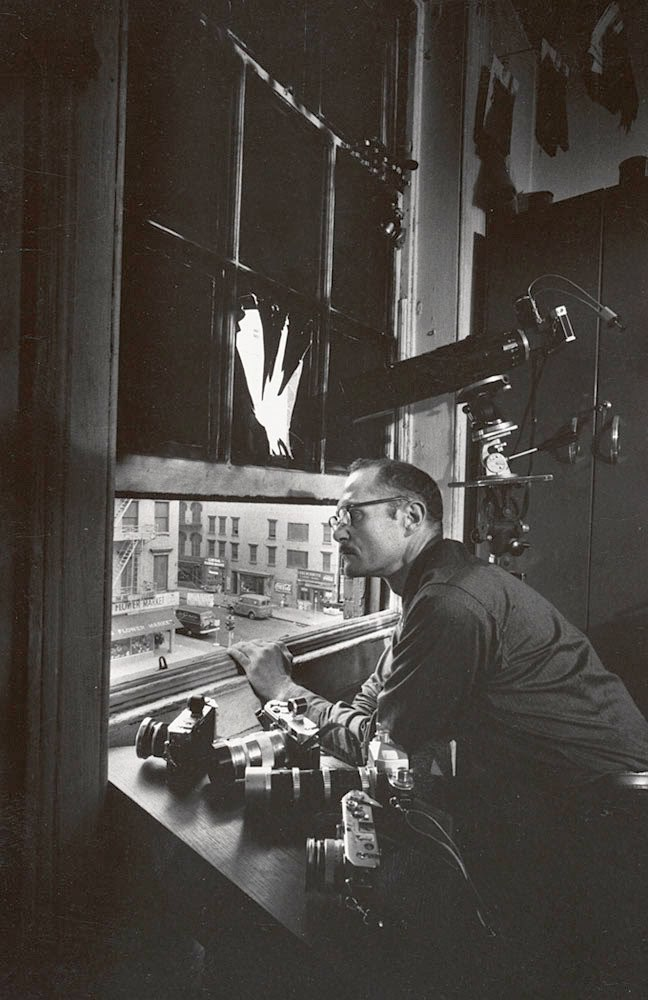 varietas:  W. Eugene Smith at fourth-floor window of 821 Sixth Avenue, circa 1957 Courtesy of the W. Eugene Smith Archive, Center for Creative Photography, The University of Arizona