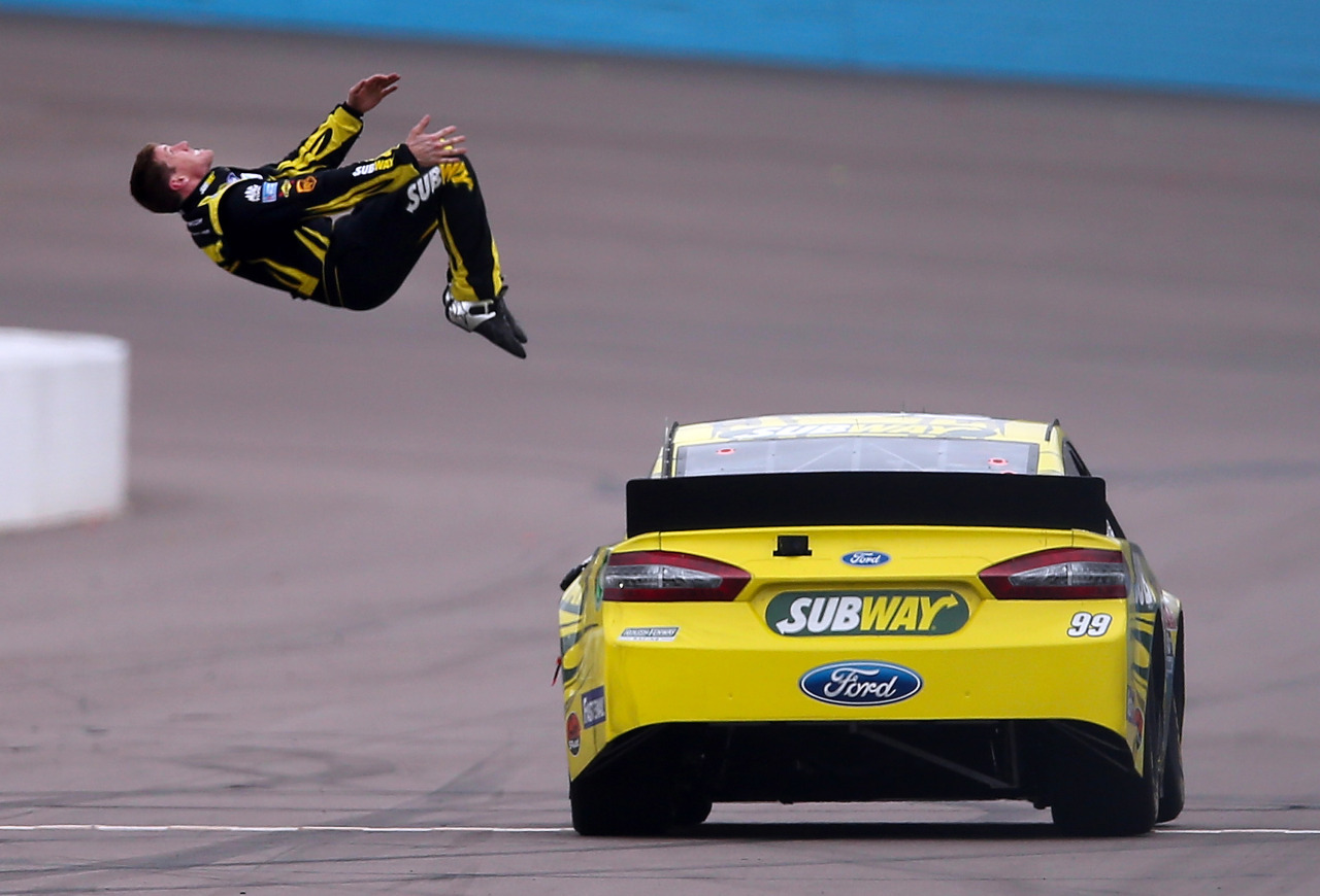 In case you missed it:  Carl Edwards, driver of the #99 Subway Ford, performs a back flip to celebrate after winning the NASCAR Sprint Cup Series Subway Fresh Fit 500. (Christian Petersen/Getty Images)