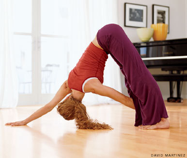 surfyogarunlive:  Asana of the Week: Revolved Downward-Facing Dog Revolved Downward-Facing Dog is a variation on the popular pose and adds a deeper stretch to the hamstrings while enhancing detoxification, balance, and full-body coordination. How to: Revolved Downward-Facing Dog Start in Downward Facing Dog.  On an inhalation, lift your left hand and reach it beneath your torso and around to your right thigh. Allow your waist and torso to twist open to the right. Work toward placing your left hand on the ground to the outside of your right foot. If that is not possible yet, rest your hand on the outside of your right leg's shin or upper thigh. Turn your head to look underneath your right arm. Keep your gaze soft. If you have no neck pain, gaze up at the ceiling. Hold for 5-10 breaths. To release, inhale as you un-twist and return your left hand to the mat. Come back into Downward-Facing Dog. Repeat the pose on the other side for the same amount of time, and then return to Downward-Facing Dog again. Benefits of Revolved Downward-Facing Dog The Revolved Downward-Facing Dog has a lot of benefits for all yoga students. Some of the major benefits are: Full-body stretching Strength-building Increased blood flow An energized and rejuvenated nervous system Relief from stress, headaches, fatigue, poor digestion, and back pain Be the first to receive weekly wellness, nutrition, and yoga inspiration delivered to your inbox, along with giveaways and exclusive event invitations. Learn more about Fern and her passion to help you become the healthiest person you know. Photo Credit: Yoga Journal