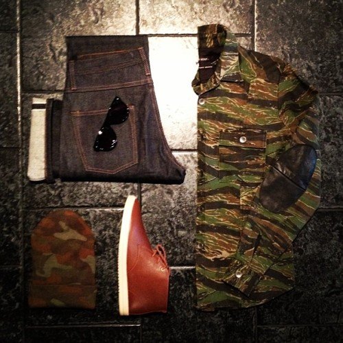 "BleeckerSt.com Men's Outfit of the Day ""Utility Jacket""  Camo Utility Jacket: http://www.bleeckerst.com/collections/mens-jackets/products/camo-utility-jacket Unbranded Selvage Denim: http://www.bleeckerst.com/collections/mens-jeans-and-pants/products/straight-leg-indigo-selvage Clae Strayhorn Chestnut: http://www.bleeckerst.com/collections/kicks Contego Kipling Black: http://www.bleeckerst.com/collections/mens-hats-and-eyewear/products/the-kipling-black Camo Beanie: http://www.bleeckerst.com/collections/mens-hats-and-eyewear/products/long-beanie-camo"