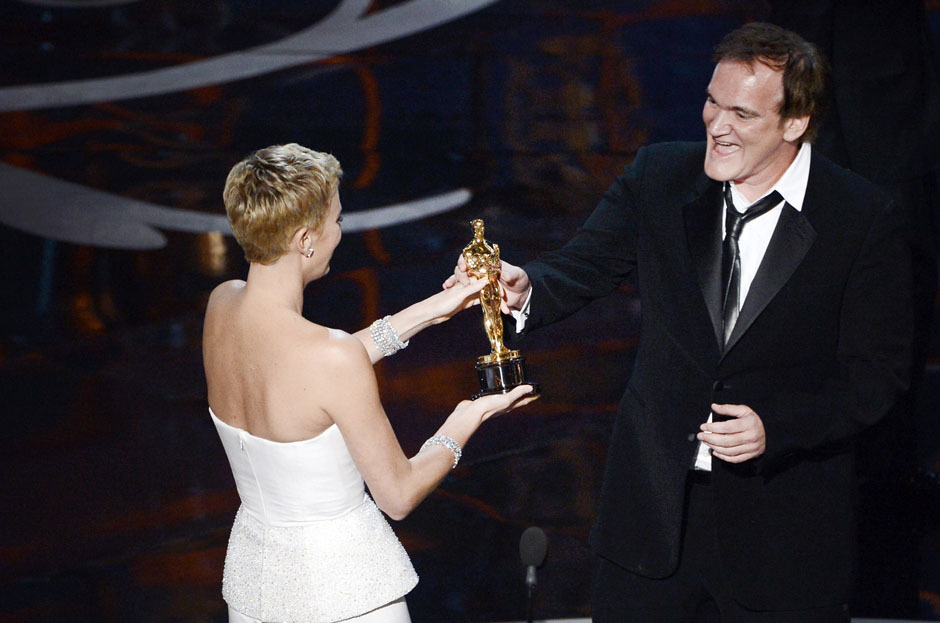 nparts:  Quentin Tarantino accepts the Best Original Screenplay award from actress Charlize Theron for Django Unchained. (Photo by Kevin Winter/Getty Images)More: http://natpo.st/XzvSrs