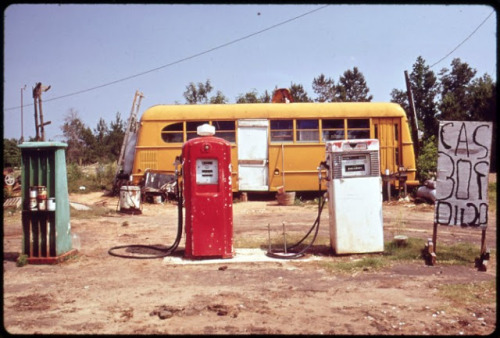 Marc St Gil's photograph of a gas station managed from a broken down bus, 1970s (via vintage everyday)