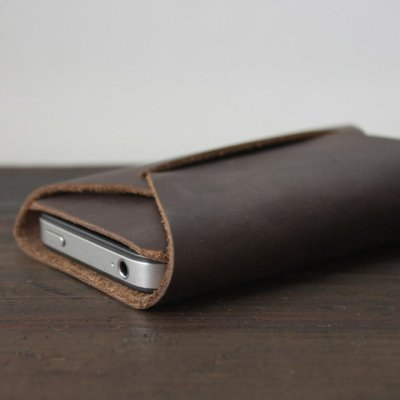 surplus-mag:  Folded iPhone Carry by Apogee There are a lot of iPhone cases out there. Some plastic, some wool, some rubber, some waterproof, some shockproof, some with secret compartments, some with built in wallets, the list goes on and on and on. But what you really need is just something that just looks really good. This folded leather case from Apogee does just that.  Hand-cut from a single piece of waxy, stone-oiled leather and held together via a series of folds and tucks, it's everything you need to protect your mobile. [via]   Beautifully simple.